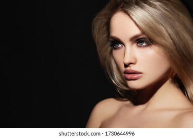 Attractive young model with tan make-up. Gorgeous Woman Face.
