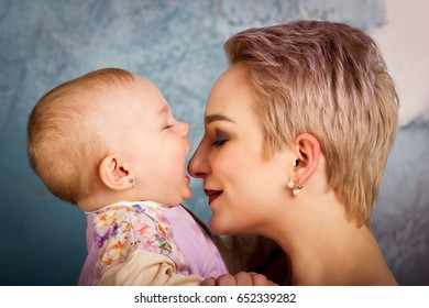 Attractive young mother playing with her daughter