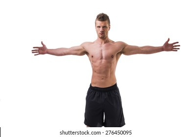 Attractive young muscle man shirtless with arms spread open, isolated on white