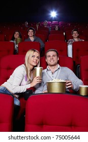 Attractive young people are watching movies in cinema