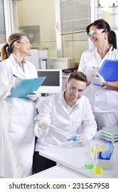 Attractive young PhD student scientist observing the blue indicator color shift after the solution destillation in chemical laboratory