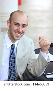 Attractive, Young Professional Mature Businessman Man Smiling While Looking at the Camera