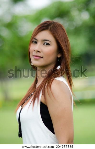 Redhead outdoor asian woman
