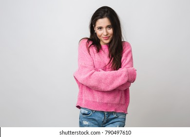 attractive young smiling stylish woman in pink sweater, feeling comfortable, casual style, posing on white studio background, isolated, winter fashion trend