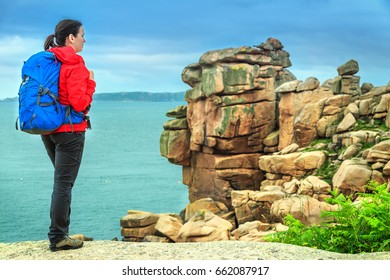 Attractive young sportive hiker woman in nature, Perros Guirec, Brittany region, France, Europe