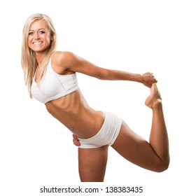 Attractive young sportswoman stretching before a training. Isolated white background.