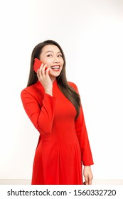 An attractive young Vietnamese woman making a phone call