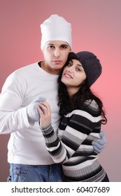 attractive young winter couple having some fun