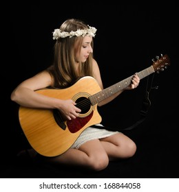 Attractive Young Woman With Acoustic Guitar
