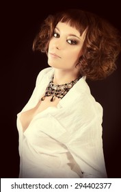 Attractive young woman alluring in white blouse. Beauty, fashion. Jewellery.