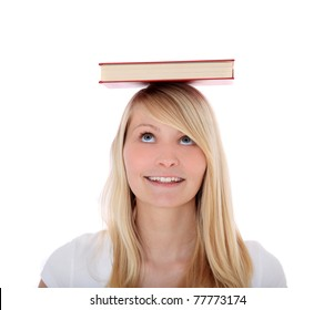 Attractive young woman balancing a book on her head. All on white background.