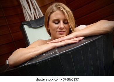 Attractive young woman in a bathtub