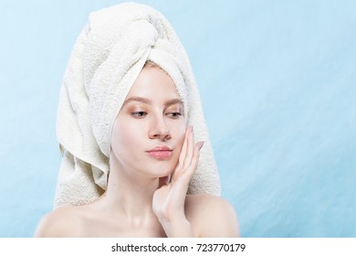 Attractive Young Woman with beautiful clean skin. Beauty treatments and cosmetology spa therapy. Blue background