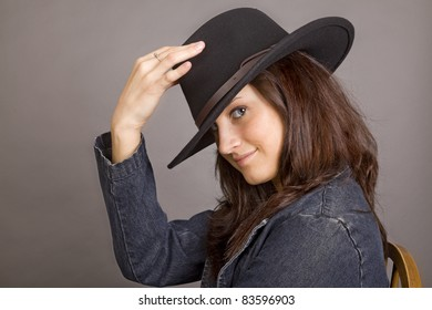 An attractive young woman with a black hat
