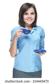 Attractive young woman in a blue blouse. Holds a blue cup. Isolated on white background