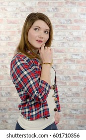 an attractive young woman in a checkered shirt