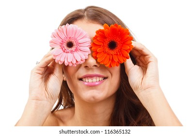 Attractive young woman covering her eyes with flowers