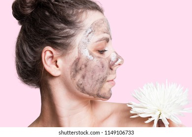 Attractive young woman with cream mask on face. Face skin care concept. Healthy smooth skin on the girl's face. Skincare