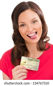 Attractive young woman with credit card showing tongue
