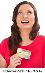 Attractive young woman with credit card looking away