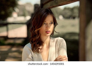 Attractive young woman daydreaming in the park