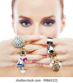 Attractive young woman with diamonds on the hands on the white background