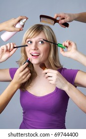 An attractive young woman doing makeup and hairstyle