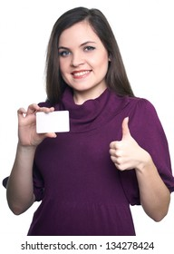 Attractive young woman in a dress. Woman holds a poster and showing thumbs up. Isolated on white background