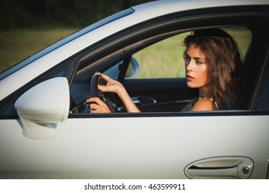 attractive young woman drive car summer day