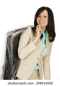 Attractive young woman with dry cleaning over her shoulder.