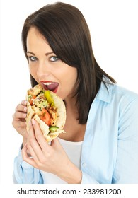 Attractive Young Woman Eating Chicken Kebab with Salad
