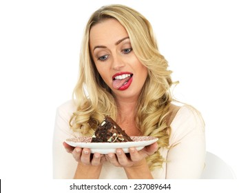 Attractive Young Woman Eating Chocolate Cake