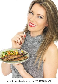 Attractive Young Woman Eating Mackerel and Salad