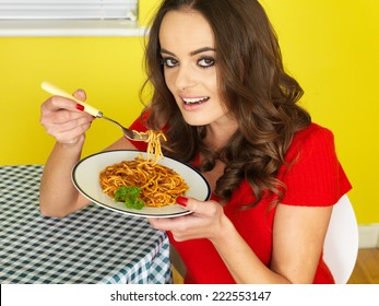 Attractive Young Woman Eating Spaghetti Bolognese