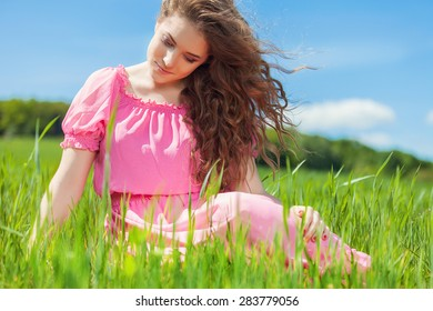 Attractive young woman enjoying her time outside in green park. Free Happy Woman.