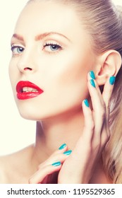 Attractive young woman face with hand near clean skin. Perfect lip red lipstick, bright make-up. Female health and facial treatment concept. Toned image