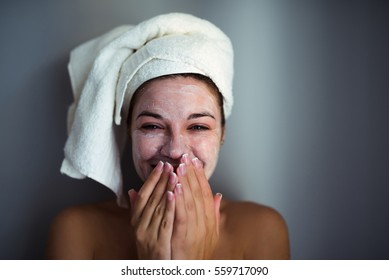An attractive young woman with a face mask.