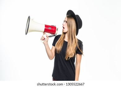 Attractive young woman in floppy hat with megaphone on white background