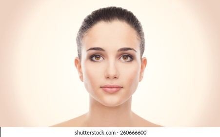 Attractive young woman with glowing face skin
