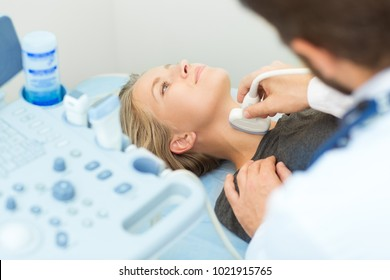 Attractive young woman having neck ultrasound scanning examination by her doctor at the local hospital healthcare medicine living people professionlism device technology sonographer survey medical