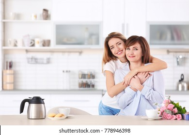 Attractive young woman with her mother at home