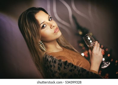 Attractive young woman holding champagne glass