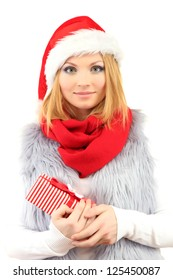 Attractive young woman holding Christmas gift, isolated on white