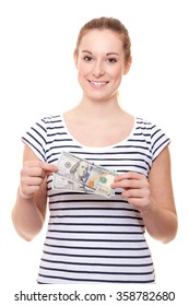 Attractive young woman holding dollar.