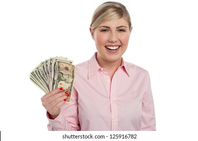 Attractive young woman holding money isolated against white.