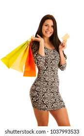 attractive young woman holding shopping bags isolated over white background