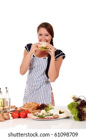 Attractive Young woman, housewife eating a healthy sandwich with salad and cheese.  Studio, white background.