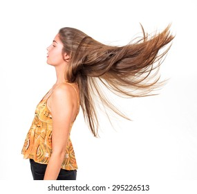 attractive young woman lets her long hair fly
