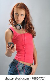 attractive young woman listening music