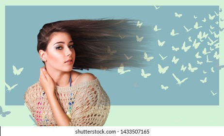 Attractive young woman with long blowing hair posing in front of blue backdrop decorated with butterflies